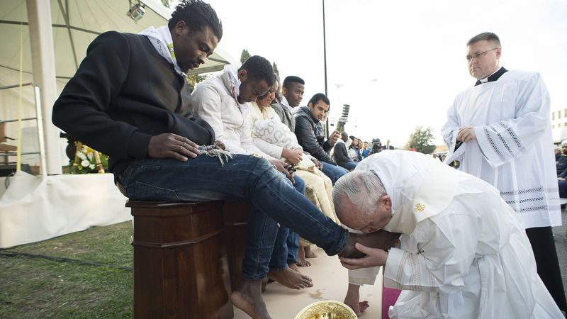 Pope Francis-KissingBlackMansFeet
